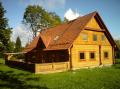 Строительство домов  из отесанных бревен